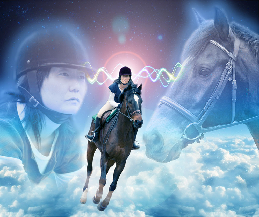 photograph of Jennifer Moon riding a horse, Beau, atop clouds in outer space with giant apparitions of Jennifer's and Beau's heads floating in the background connected by psychic waves