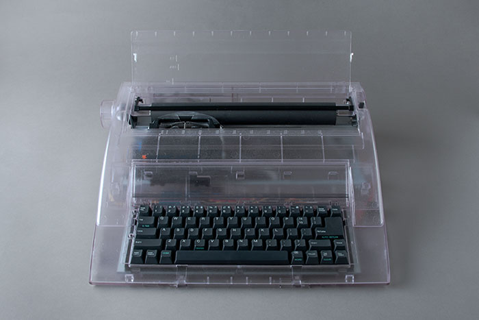 photograph of a clear plastic typewriter